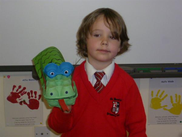 George & his toy dragon.