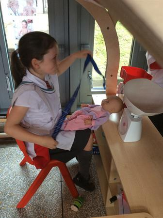 Nurse Anna measuring the length of the baby