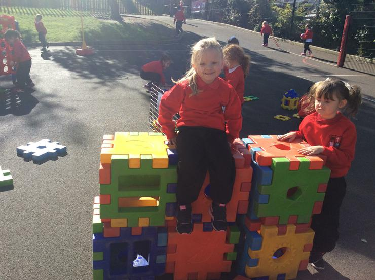 Caoimhe is sitting on humpty wall