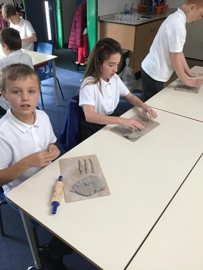 Working hard to make our clay vases.