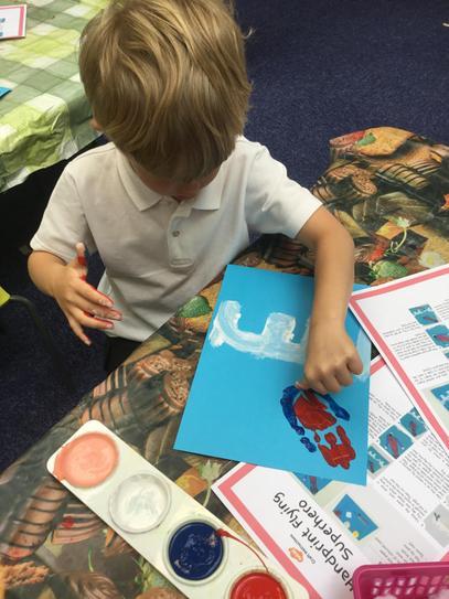Making handprint superheroes!