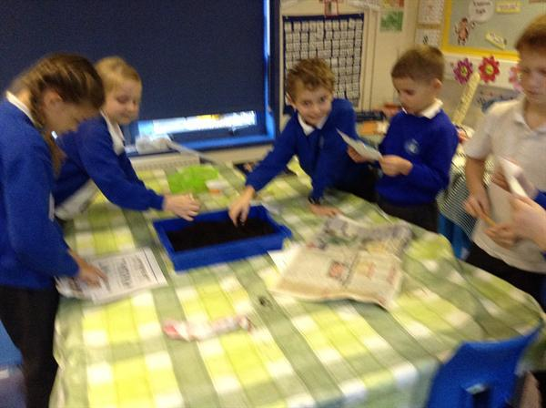 Year Three's carrying out an Archaeological Dig
