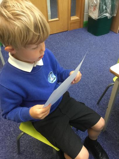 Reading a list for handprint superheroes.