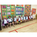 Reception children are learning a superhero dance.