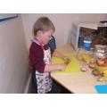 Lewis carefully chopping.