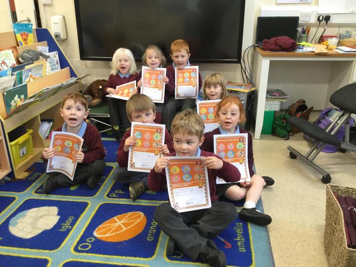 Receiving certificates from Miss Zoe
