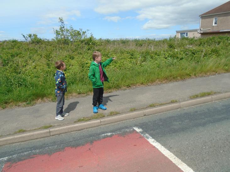 Lewis and Olly looking up the hill for traffic.