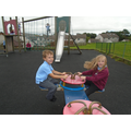 Olly and Aurora enjoy the see-saw