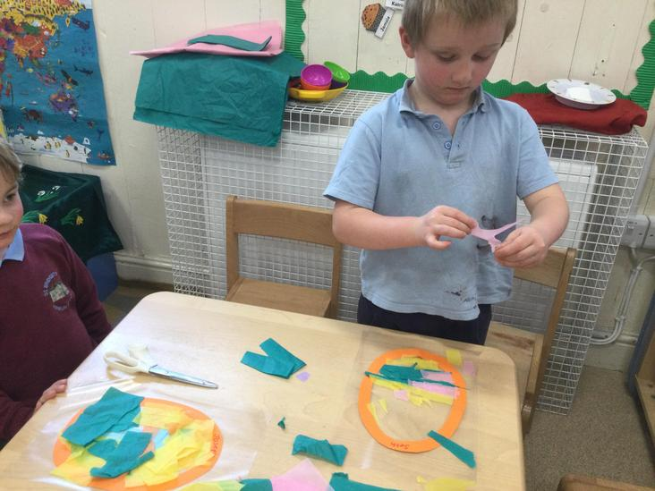 Seth concentrating hard - they all looked amazing on the classroom window.