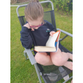 Scarlett reading in the garden