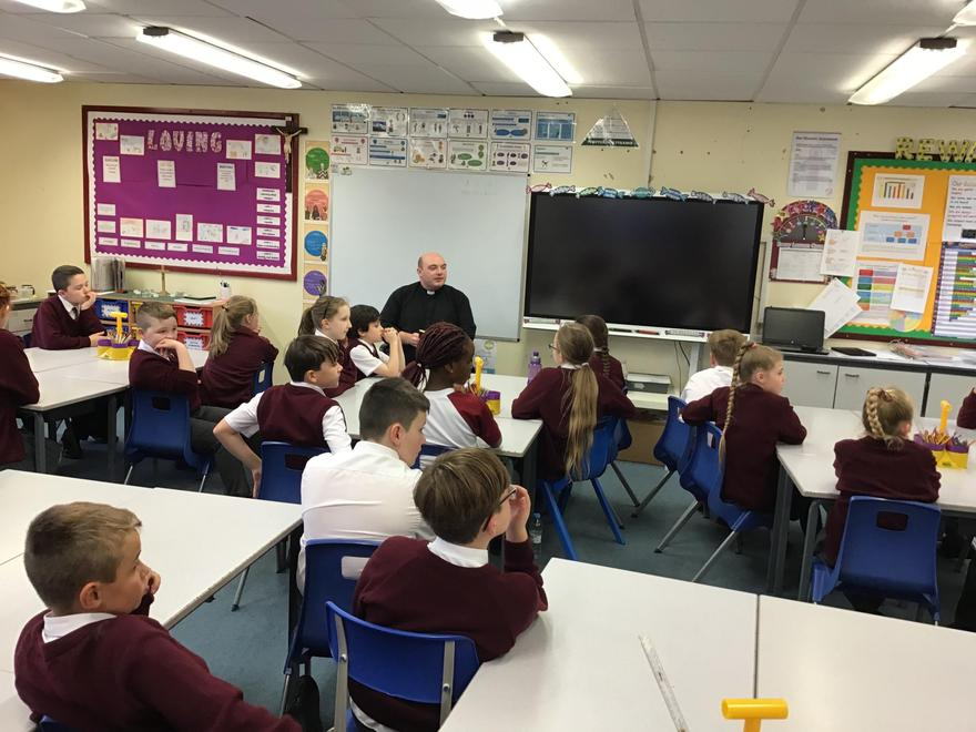 Fr. Dominic regularly visits our classrooms