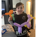 Oliver making animals with balloons