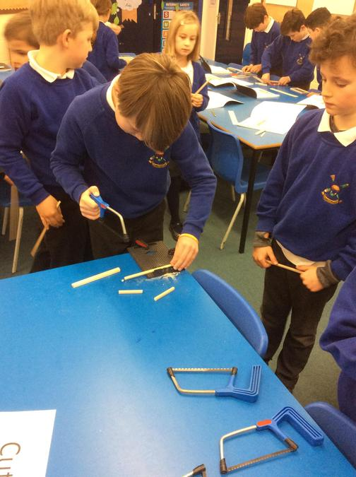 We used saws to cut out wood to the correct length.
