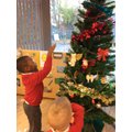 Decorating the Nursery Christmas tree!