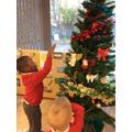 Decorating the Nursery Christmas tree!