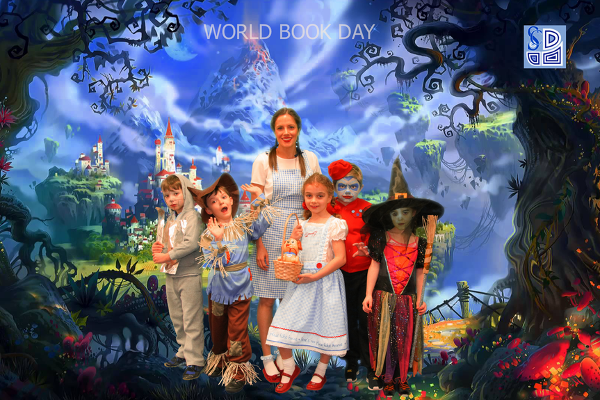 Year 2 pupils with teacher on World Book Day
