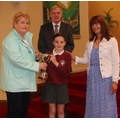 Kathleen Grogan presents the Paddy Grogan Cup to Katie Marley