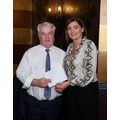 Mrs Ursula McElroy presents Mr Conway with cheque