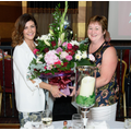 Mrs M Kelly presents Mrs McElduff with bouquet
