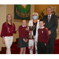 Mrs Corey presents the John Gervin Cup to Grace McCullagh and Ronan Hurson