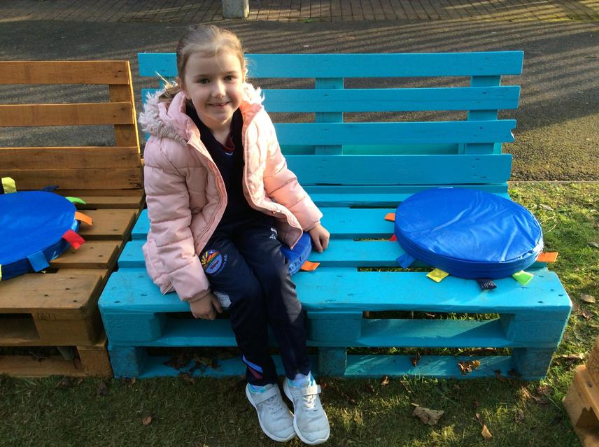 Annalise helped paint the benches for our garden