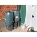 Two water butts are nice and full from the rain.