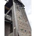 Scaling a climbing wall