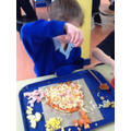 Adding our individual healthy pizza toppings