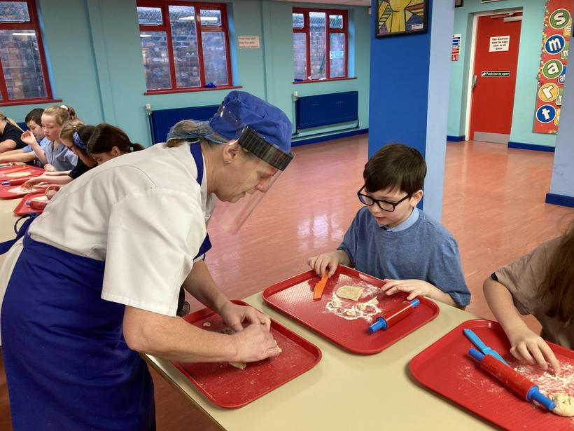 Our school chef, Toni, showing the children the best techniques