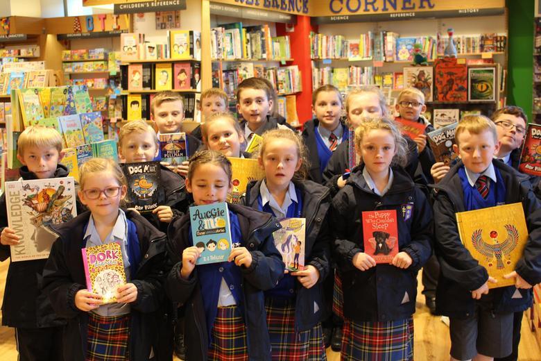 The children with their chosen book