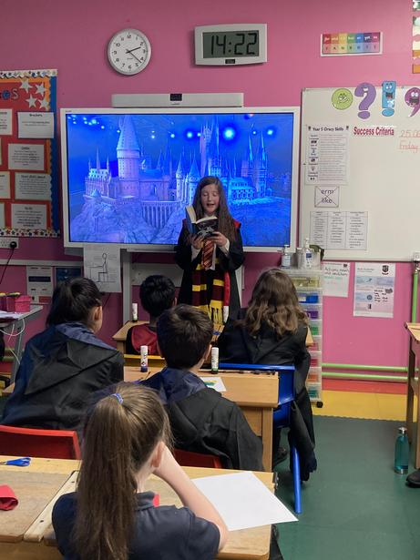 Hermione (a Reading Ambassador) reading part of her book to other classes