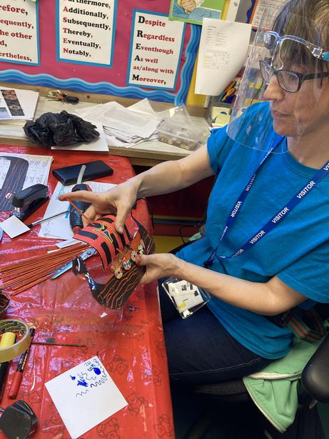 Our resident artist showing the children how to construct their Viking longboat