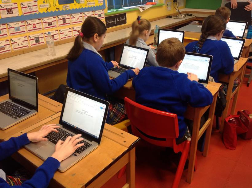 Using the Apple Macs to complete our classwork on Google Classroom