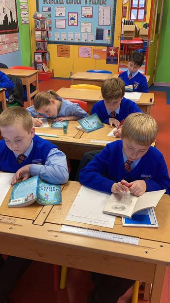 Writing our book reviews of Philip Pullman's 'Clockwork'.