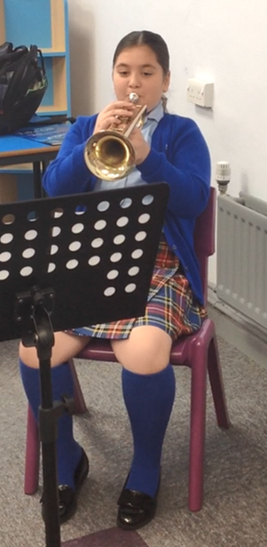 Learning in our brass peripatetic lessons.