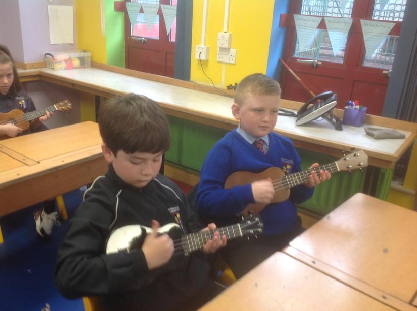 Practising strumming a chord