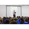 Frank Cottrell Boyce reads from his books to us.