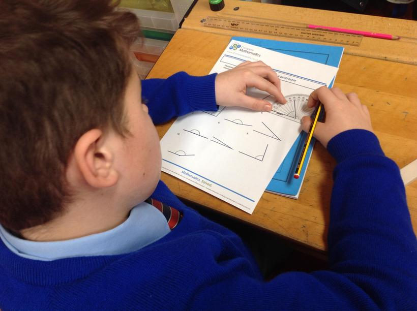 Using a protractor to measure angles