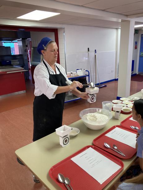 Chef demonstrating her expertise.