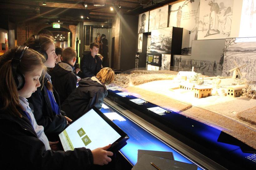 Exploring a replica of a typical 'slave village'