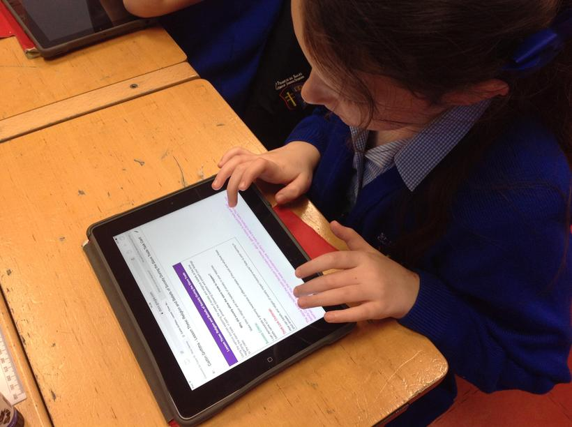 Using the iPads to complete tasks