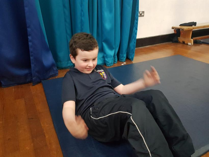 Working independently on his sit ups