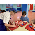 Year 5 - Receiving expert help from our cook