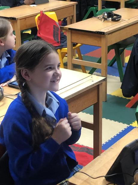 One pupil couldn't keep the smile off her face whilst she listened