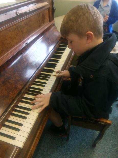Playing the piano at Homebaked for the community