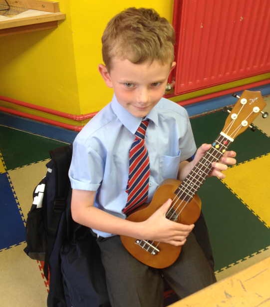 Practising holding the ukulele independently