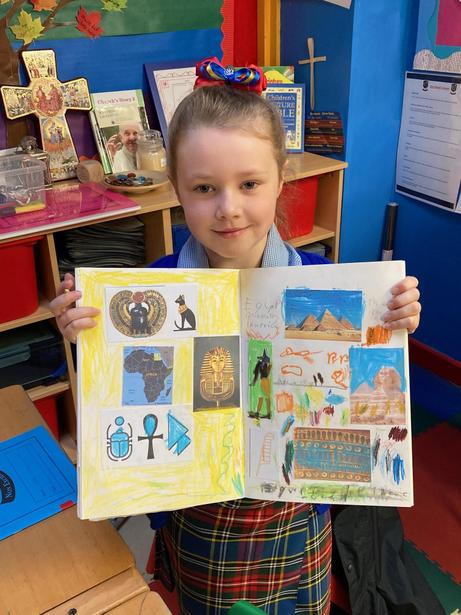Wow! A proud pupil with her Egyptian Artwork