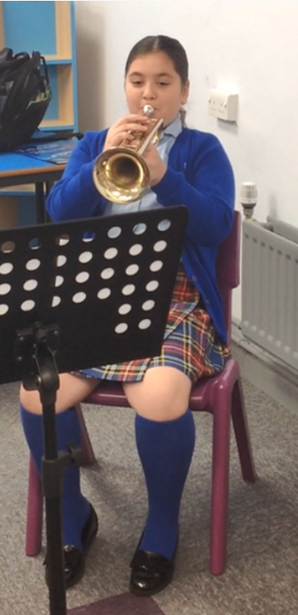 Learning in a brass lesson