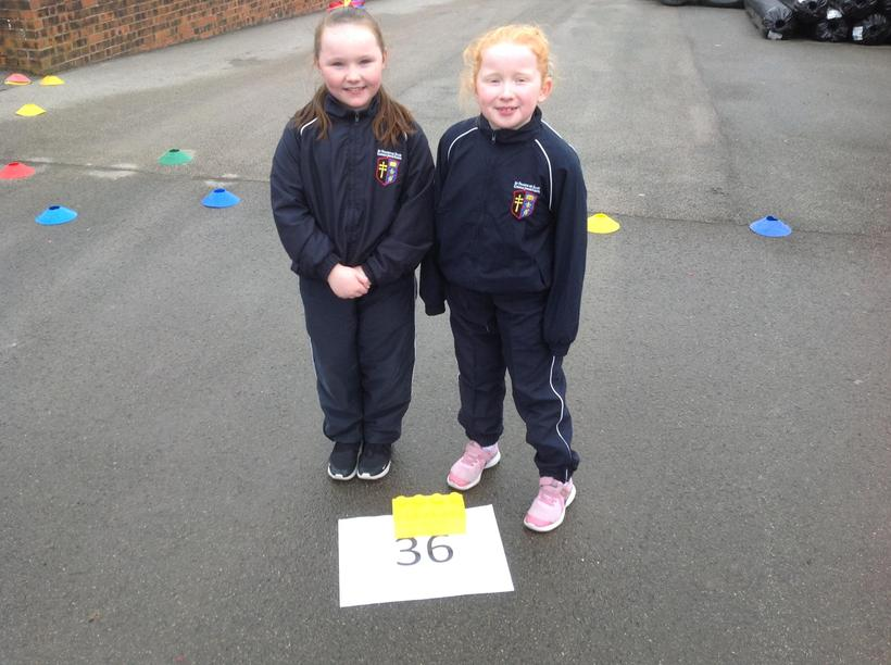 Two proud Y4 girls finding fractions of amounts!