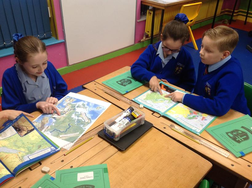 Exploring maps to locate rivers and mountains